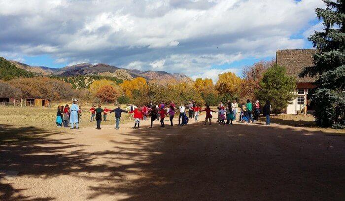 Friendship circle dance at Rock Ledge Ranch