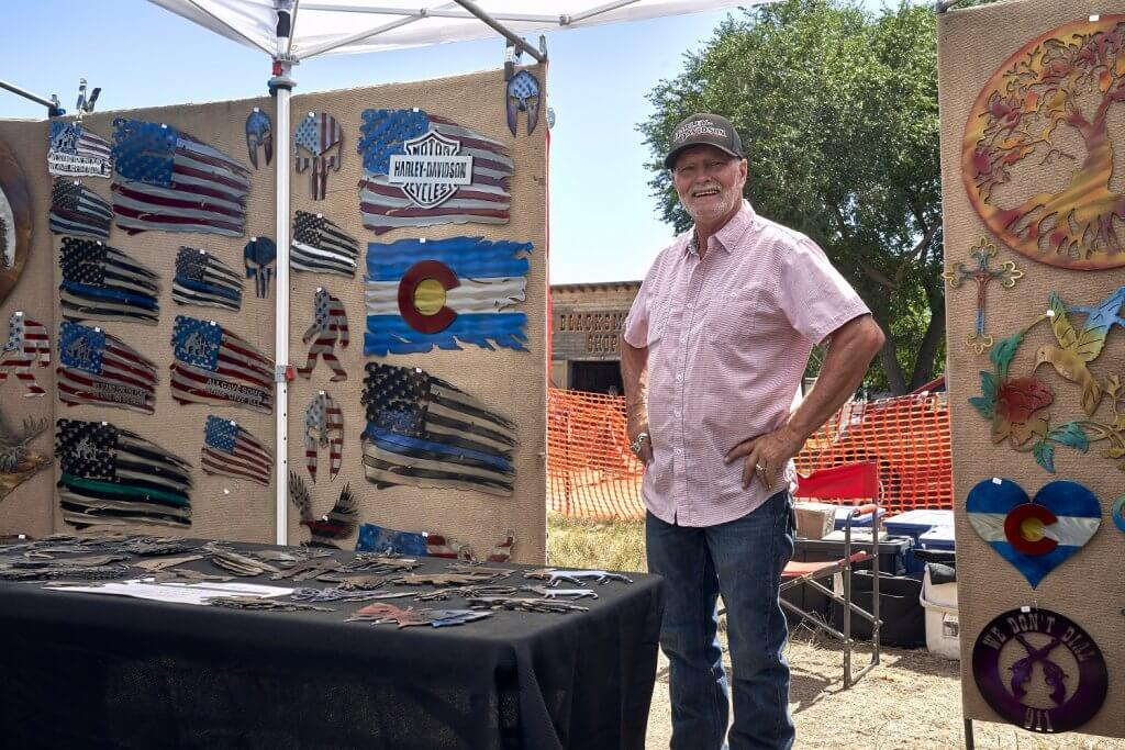 Artisan vendor displaying items available for sale during Folk Art Festival.