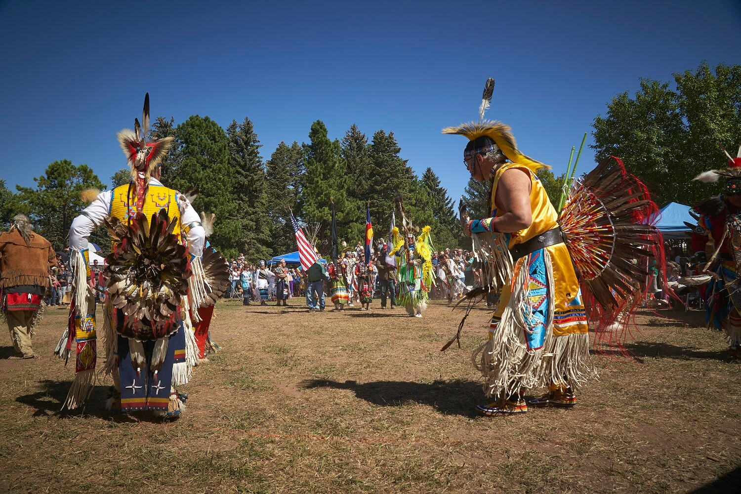 Grand Procession for Powwow, Dancers in American Indian Native fancy dress.